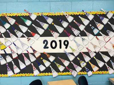 I love the movement in this math bulletin board display of Ms. Degnan's matholution pennants.