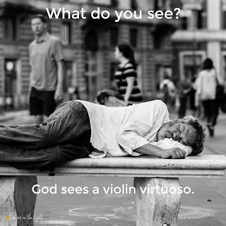"Homeless man sleeping on a bench. Caption says ""What do you see? God sees a virtuoso violinist."""
