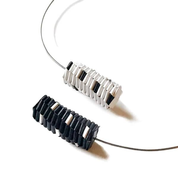 folded black and white paper necklace on stainless steel wire