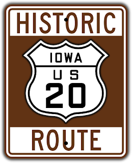 brown and white highway sign with shield motif for historic US Route 20