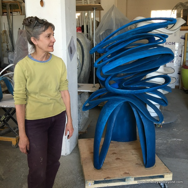 "artist Mary Oros next to her ""Blue Moves"" concrete sculpture in Benicia, California"