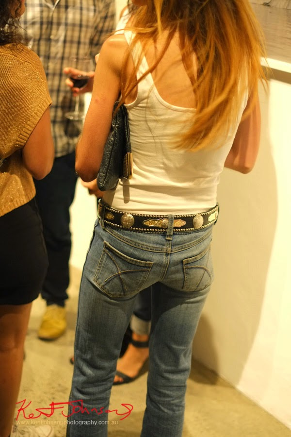 White singlet, clutch purse, blue jeans and western belt. at Black Eye Gallery for MELT.