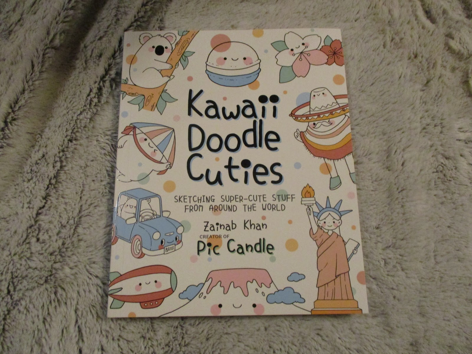Kawaii Doodle Cuties Sketching Super-Cute Stuff From Around The World By  Zainab Khan who created Pic Candle from Quarto Knows Publishing.