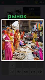 рынок на котором торгуют девушки в национальных нарядах азии