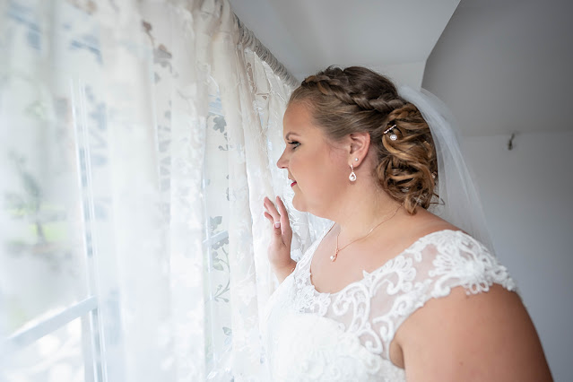 Bride looking out the window Magnolia Manor Wedding Photos by Stuart Wedding Photographer Heather Houghton Photography