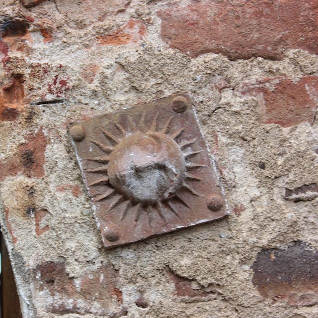 Supax Church sun symmbol decoration