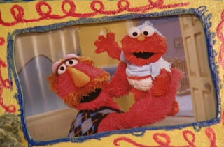 Louie shows Elmo his baby photos. Sesame Street Elmo's Potty Time