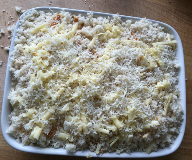 dish complete with breadcrumbs and cheese on top