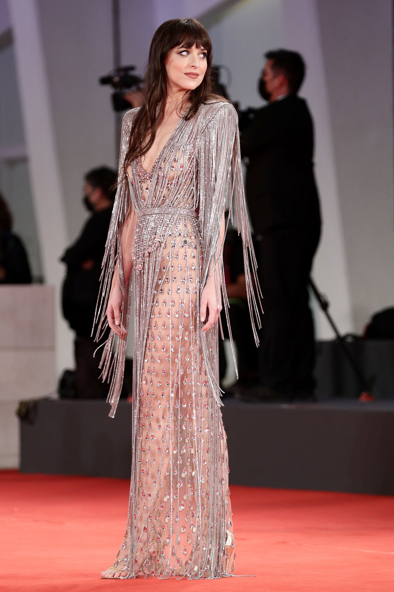 """Dakota Johnson wore a #Gucci fully embellished crystal fringe gown to the premiere of """"The Lost Daughter"""" during the 2021 Venice Film Festival"""