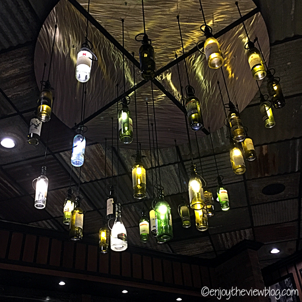 Close-up of wine bottle chandeliers at Grimaldi's in Miramar Beach