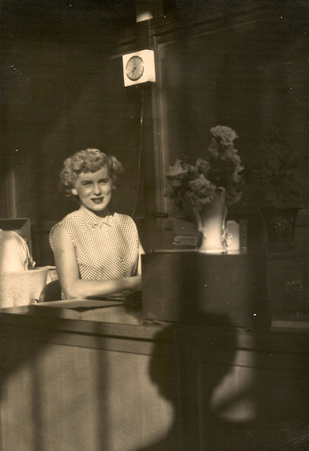 Mary E. (Dixon) Traina, working at her desk. Date and location unknown. Photo property of E. Ackermann.