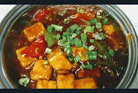 Chilli paneer gravy serving in a bowl