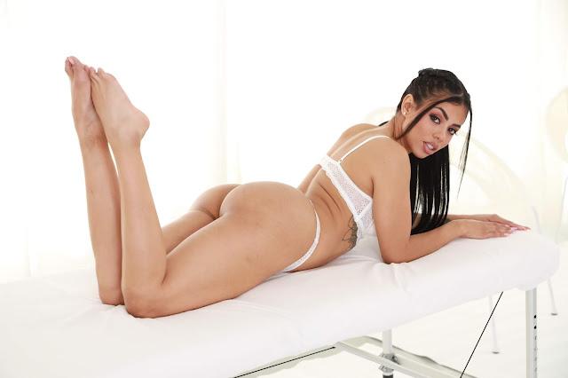Canela Skin lying backwards showing sexy ass legs up