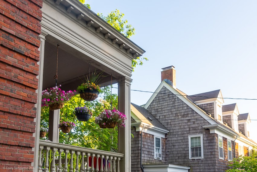 Portland, Maine USA June 2020 photo by Corey Templeton. A nice display of hanging plants on a West End porch.