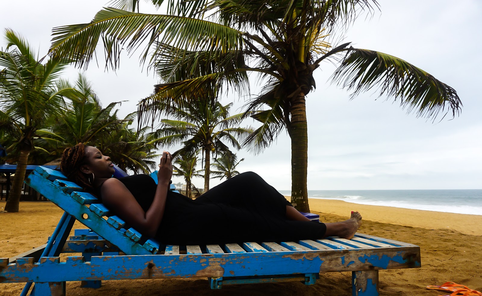 Nigerian blogger, lade ibikunle at Macello beach, lome, Togo