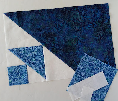 Placemat in progress, with blue and white triangles