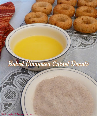 Baked Cinnamon Carrot Donuts are studded with carrots, full of cinnamon flavor, and topped with a sprinkling of cinnamon sugar. | Recipe developed by www.BakingInATornado.com | #recipe #donuts