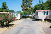 A road leading into a mobile home park, with homes on either side