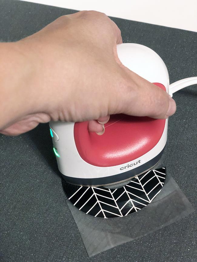 Use easy press mini to make iron on vinyl stick to faux leather