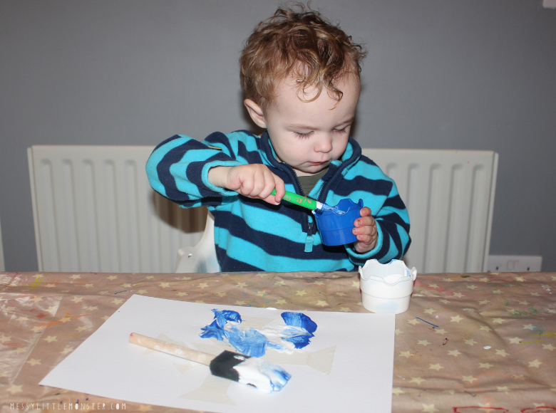 toddler painting snowflakes
