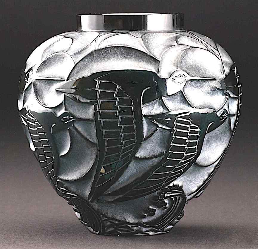 color photograph of a 1931 Lalique vase with flying birds