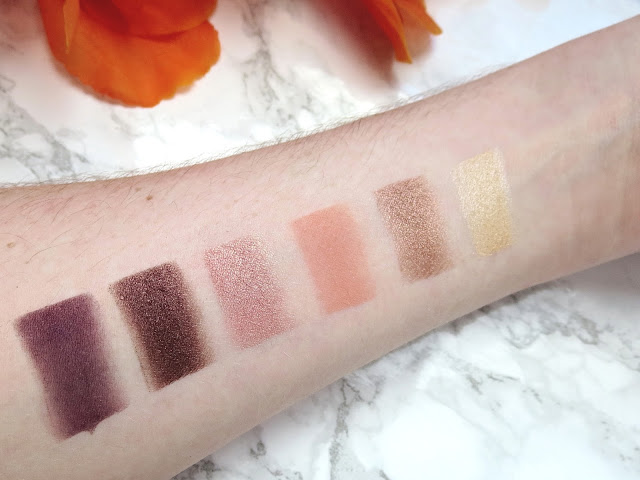 a picture of Too Faced Sweet Peach Palette (swatch, swatches) :Nectar (pearly peachy cream), Cobbler (peachy pinked bronze), Candied Peach (matte coral with violet shimmer), Bellini (gilded peach), Peach Pit (satin perfect rasin), Delectable (matte smoky amethyst)