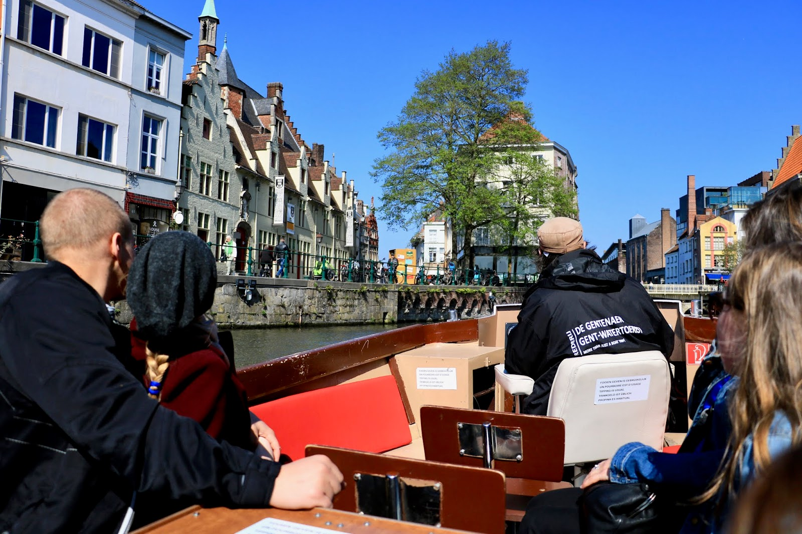 Travel blogger Kathleen Harper on a boat tour in Ghent, Belgium on the Lys river