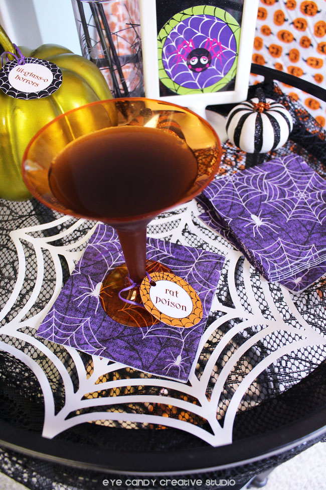 rat poison tag, halloween party bar cart, spider web, pumpkins, spider