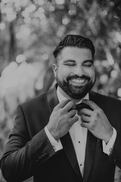Candid moments of groom in natural outdoor setting