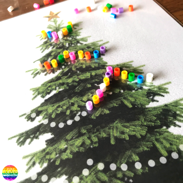 Christmas Fine Motor Skills Mats - help build and strengthen fine motor skills with the help of these Christmas themed printable play mats | you clever monkey