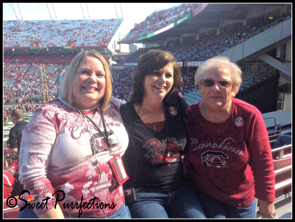 Mom Paula with friends at a football game