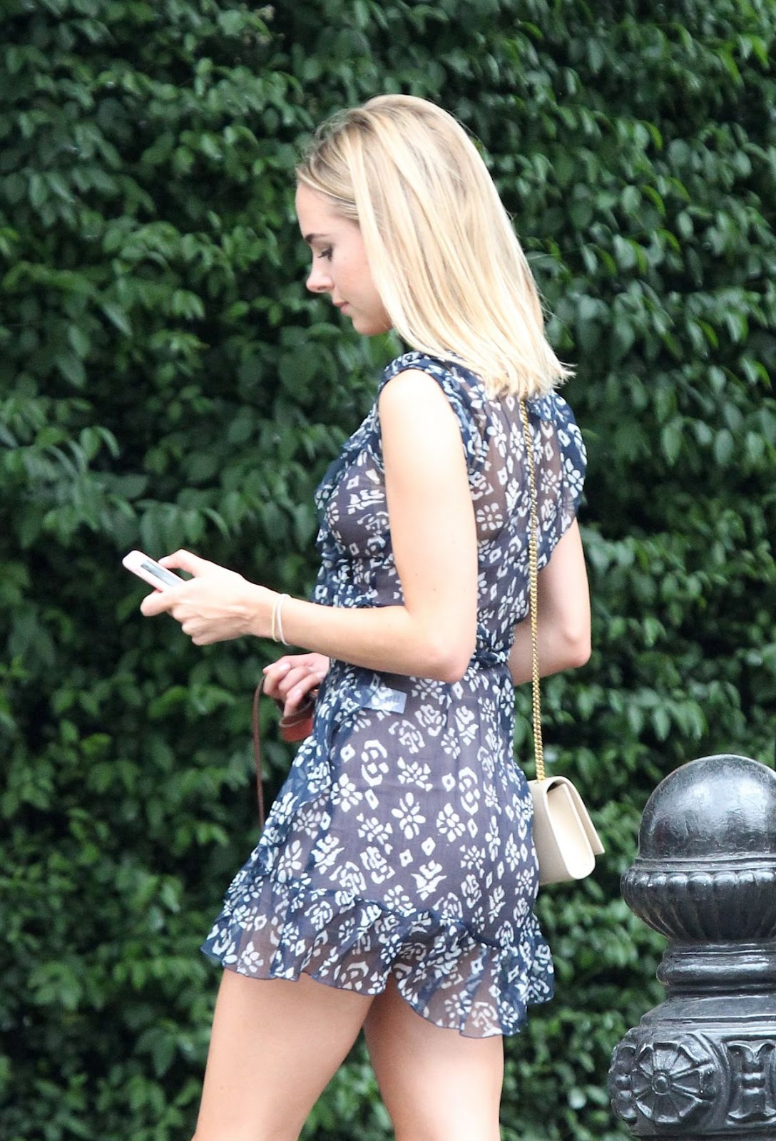 Photos of Kimberley Garner walks with Her Dog in London