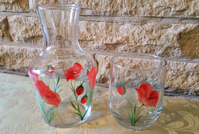 The jug and glass with a poppy design on from the Hand Painted Carafe Set