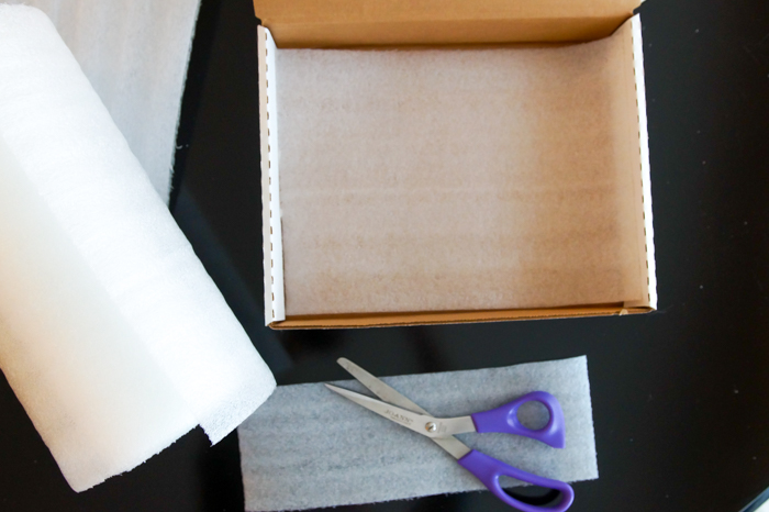lining a box with foam sheet for packaging cookies