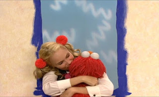 Ms. Noodle hugs Elmo and kisses him many times. Sesame Street Elmo's World Building Things The Noodle Family