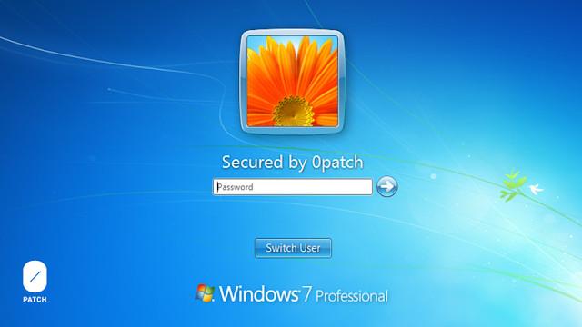 Schermata login Windows 7 con dicitura messo in sicurezza da 0patch