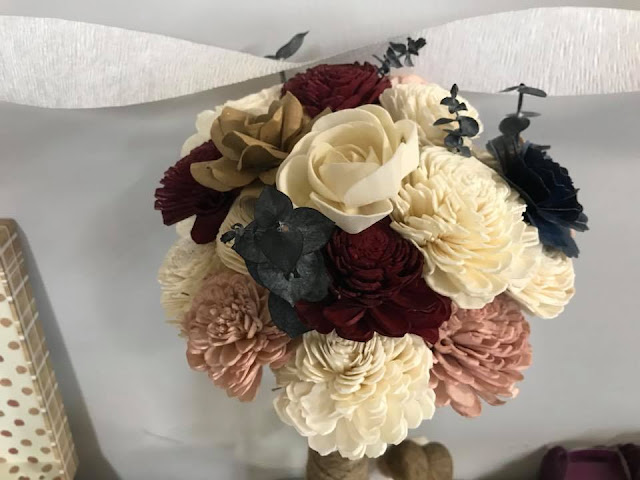 Wood flowers used as a budget friendly alternative to a real wedding bouquet