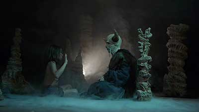The Demons Rook El demonio enseñando al niño