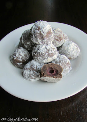 plate of chocolate covered cherry snowball cookies