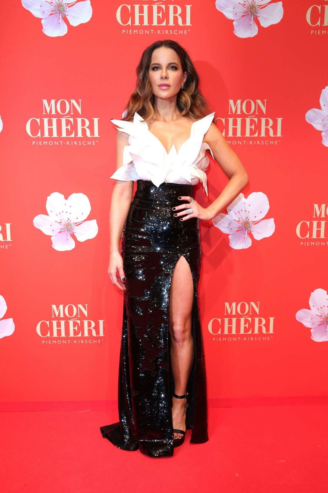 Kate Beckinsale exudes glamour in a sequinned gown with a racy thigh high split at ball in Munich