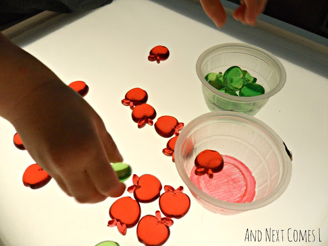 Apple themed toddler activities for the light table
