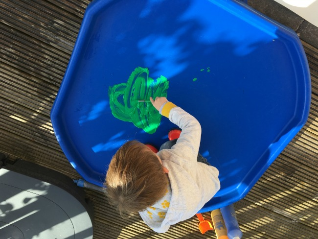 toddler-on-tuff-spot-painting-with-green-paint