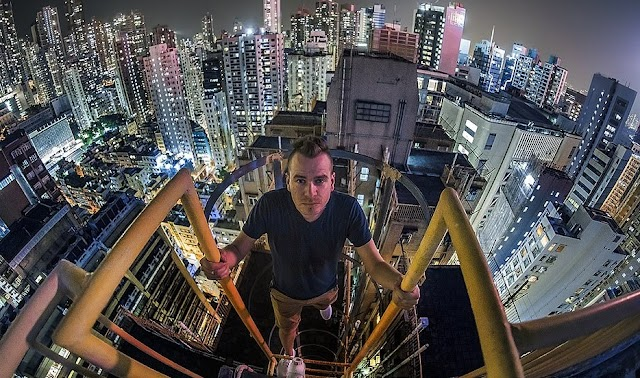 Driver of train takes a risk to take photos on the roofs of skyscrapers