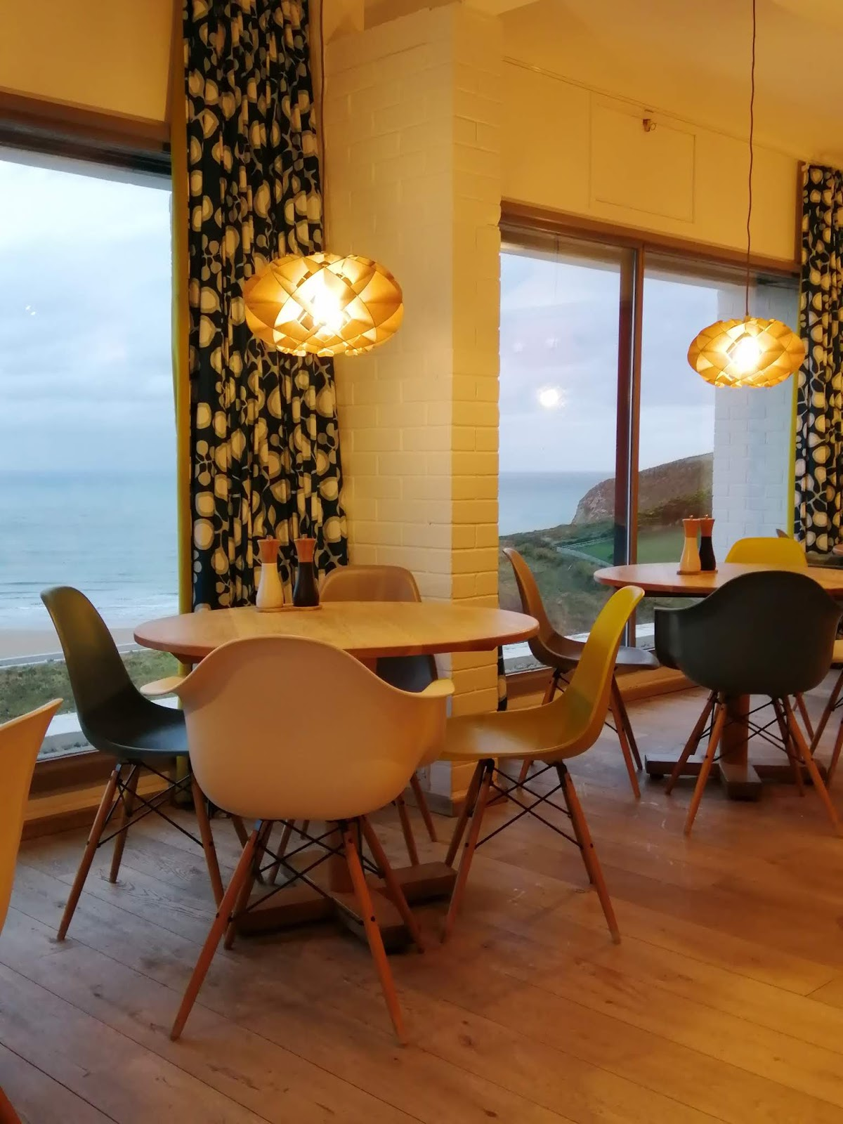 Watching the winter seas in the Mid Century Modern hotel at Bedruthan Steps
