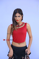 Telugu Actress Nishi Ganda Stills in Red Blouse and Black Skirt at Tik Tak Telugu Movie Audio Launch .COM 0060.JPG