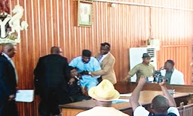 VIDEO: Edo State lawmakers exchange punches, attack eachother with chairs