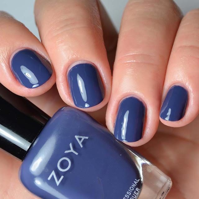 indigo creme nail polish swatch on four fingers