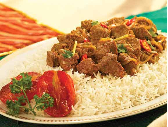 Heat the oil in a deep pot and fry ginger garlic paste Beef Masala Recipe