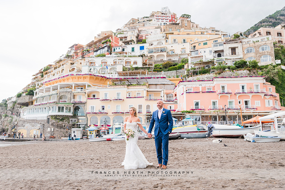 Bride & groom walking on Positano beach
