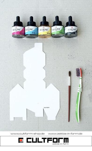 Die Hausbox von Cultform. Ein eindruchsvolles und doch einfaches DIY: kleine Geschenke individuell modern verpacken im aktuellen Watercolor-Trend: Anleitung, Wasserfarben, Pinsel, Zahnbürste, Bastelbogen